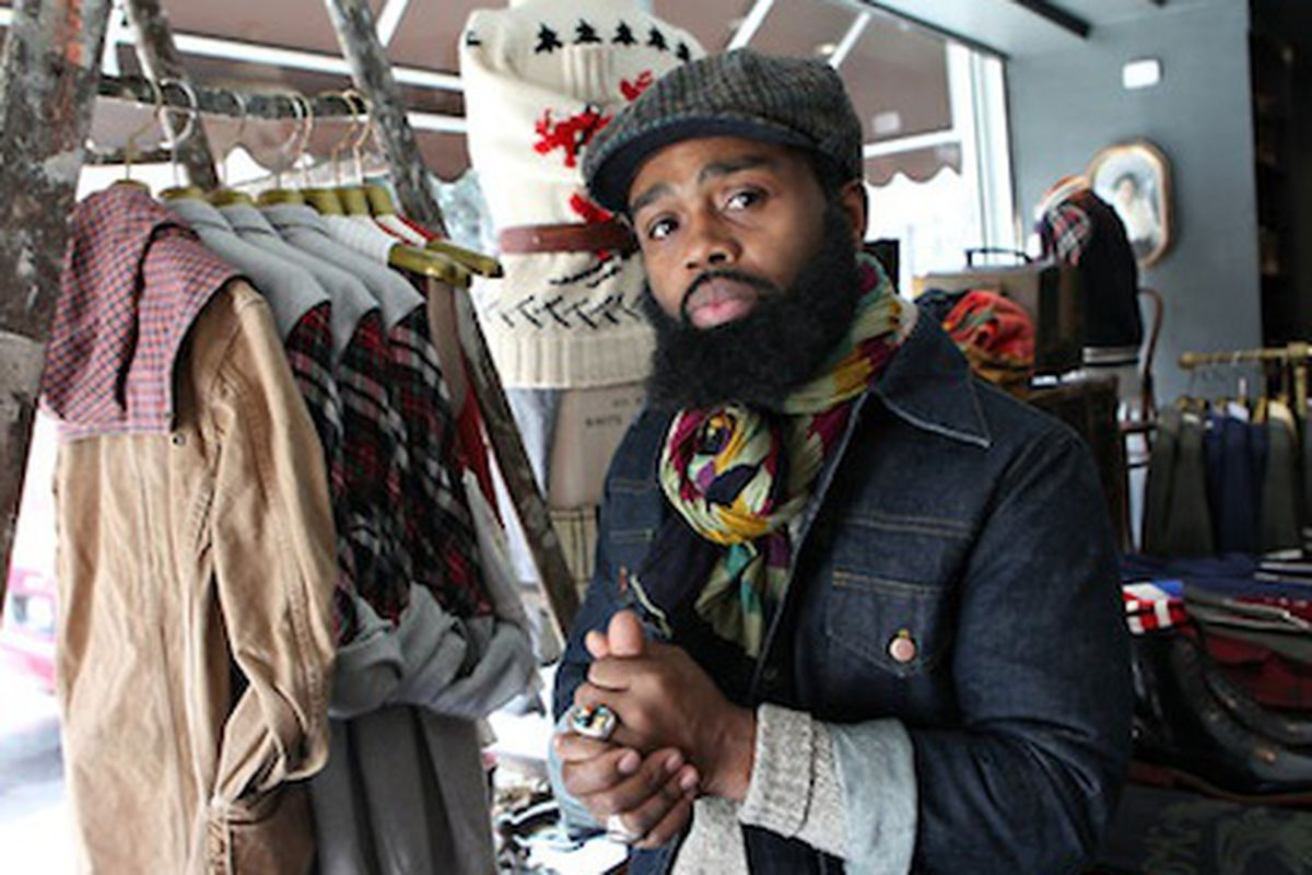 """Besides being the brains behind the lauded <strong>Brooklyn Circus</strong>, Ouigi knows how to tie a scarf and wears a beard well. Image via <a href=""""http://www.nytimes.com/2011/01/06/fashion/06close.html?ref=fashion"""">NYTimes</a>."""