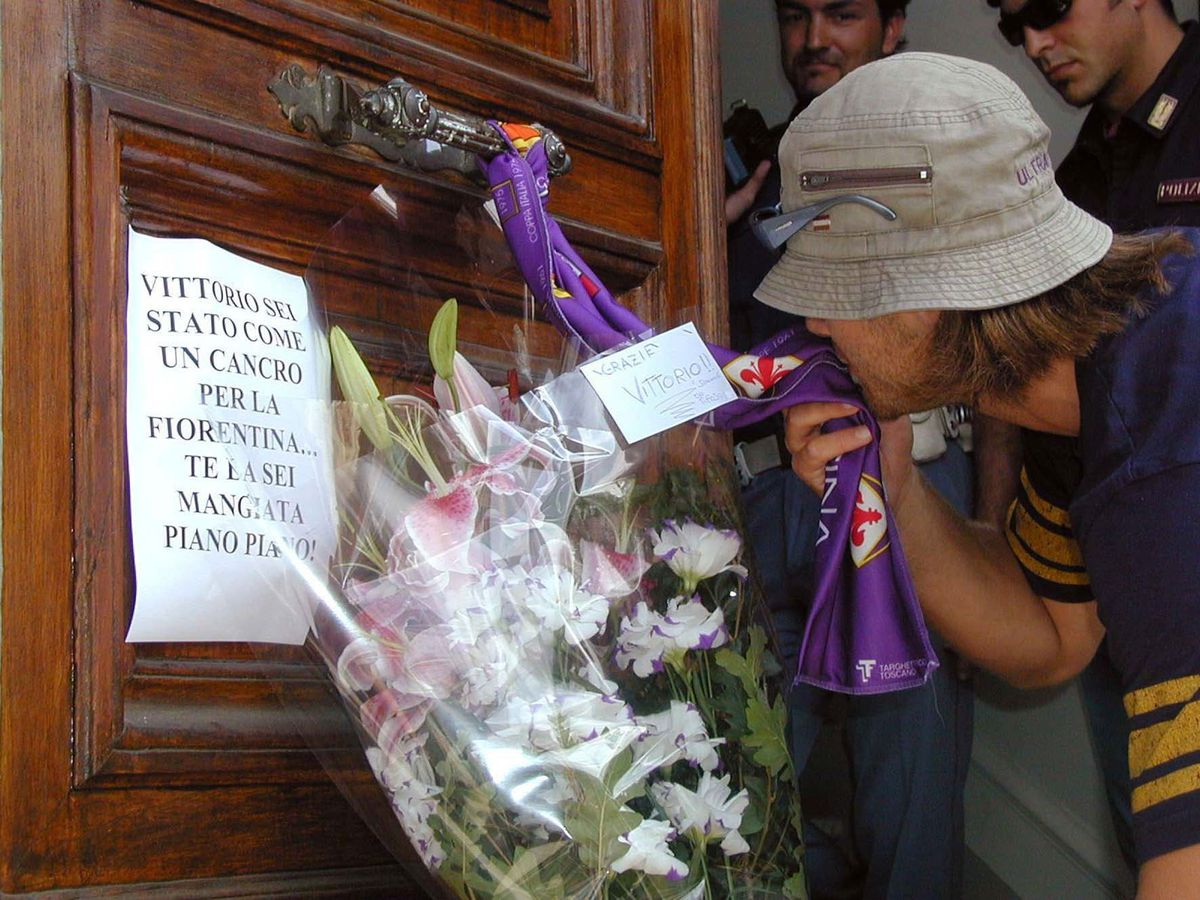 An AC Fiorentina fan marks the 'death' of the club following the news that their club has been relegated from Serie B due to financial problems and will cease to exist.