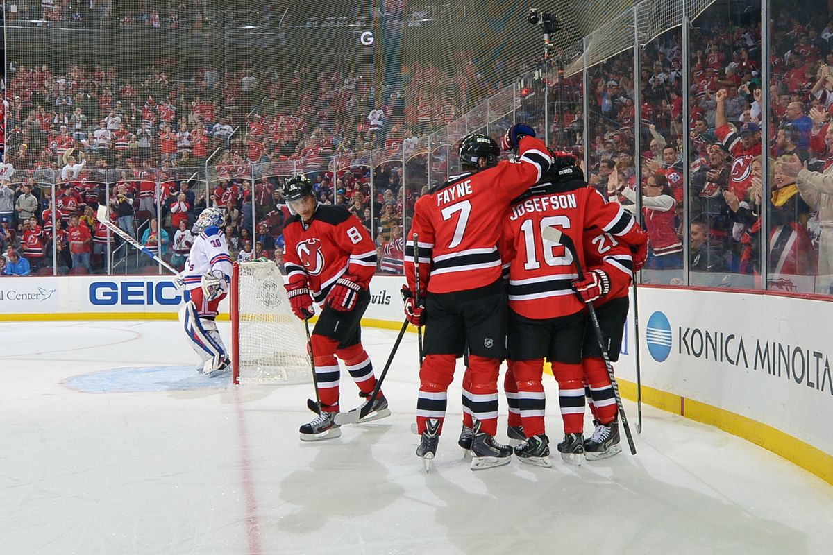 The Devils celebrating as Henrik Lundqvist wonders whether the night would get worse. (It would, this was after the first goal allowed.)