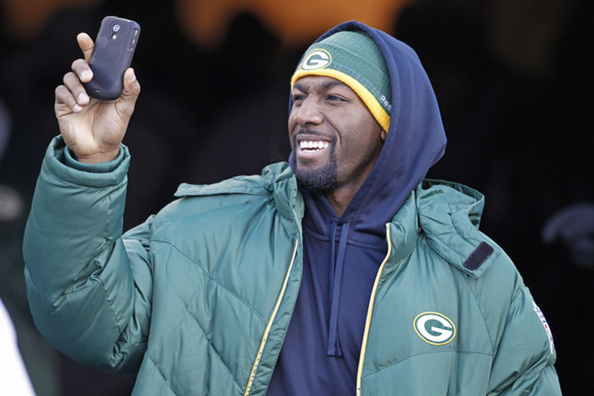 GREEN BAY WI - FEBRUARY 08: Green Bay Packers wide receiver Greg Jennings shoots video on his phone while entering Lambeau Field during the Packers victory ceremony on February 8 2011 in Green Bay Wisconsin.  (Photo by Matt Ludtke/Getty Images)