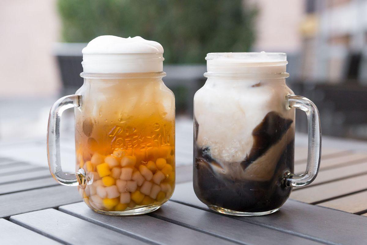Melon tea with whipped cream and small taro balls, left, and milk tea with purple rice porridge at Meet Fresh