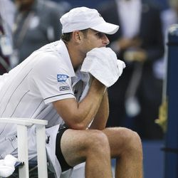 Andy Roddick pauses in his chair after his fourth round loss to Argentina's Juan Martin Del Potro at the 2012 US Open tennis tournament, Wednesday, Sept. 5, 2012, in New York. Roddick said he would retire after the match. (AP Photo/Charles Krupa)