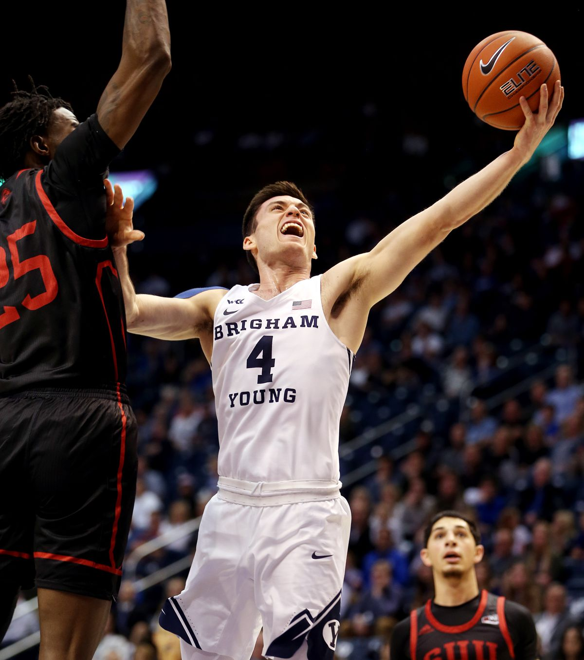Brigham Young Cougars guard Alex Barcello (4) puts up a shot with Southern Utah Thunderbirds forward Dwayne Morgan (25) defending on the play as BYU and Southern Utah University play in a NCAA basketball game in Provo at the Marriott Center on Wednesday, Nov. 13, 2019.