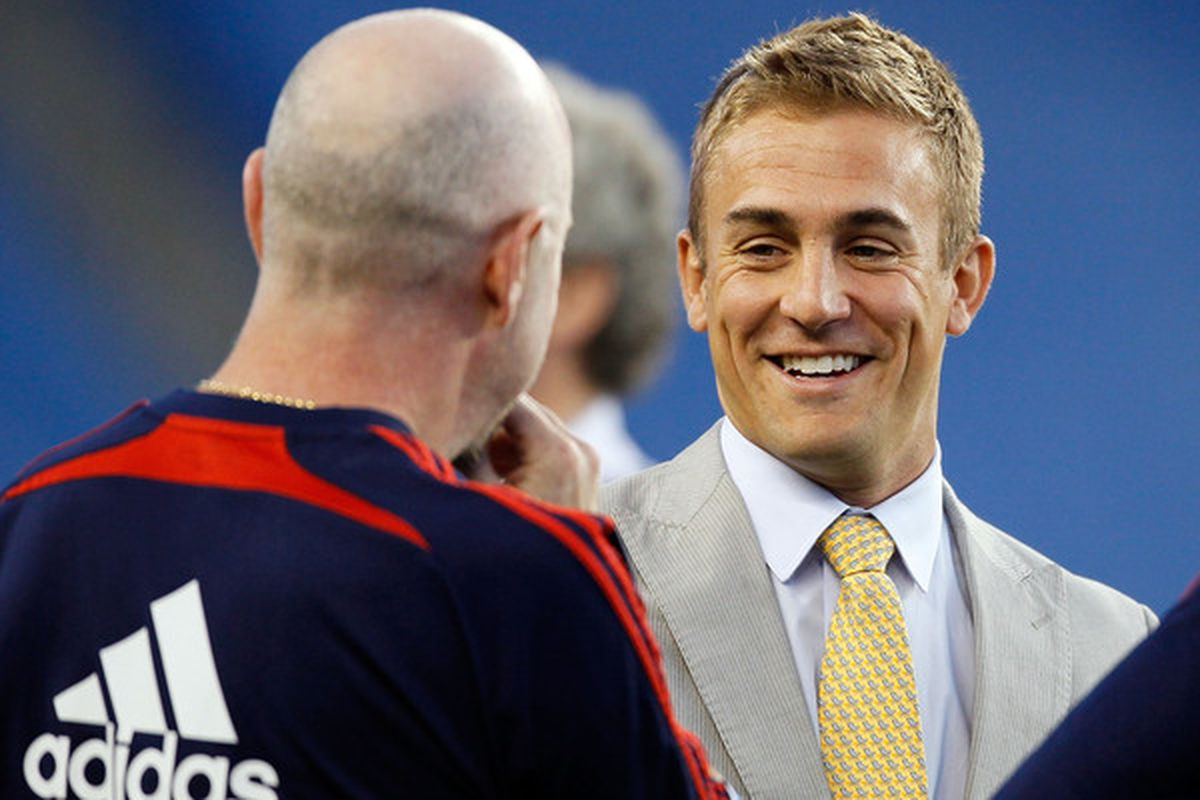 Taylor Twellman chats on the sideline before a game in Foxboro, Massachusetts. (Photo by Gail Oskin/Getty Images)