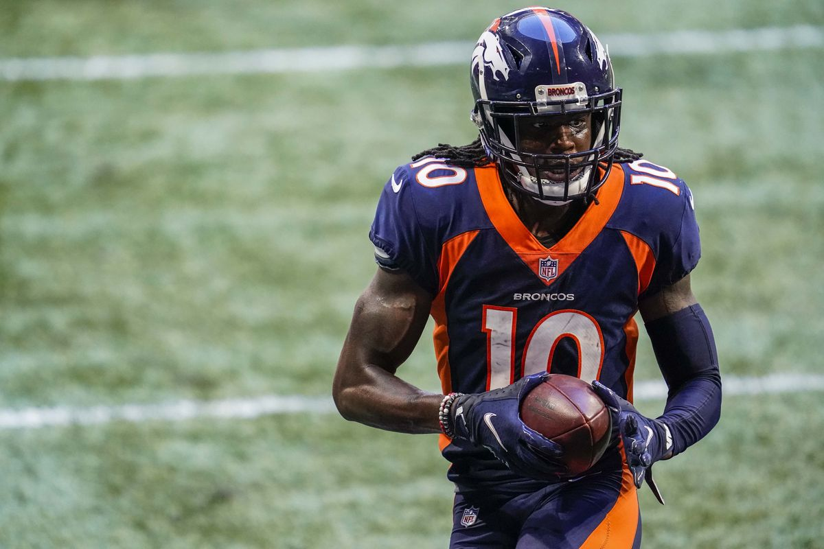 Denver Broncos wide receiver Jerry Jeudy scores a touchdown against the Atlanta Falcons after making a catch during the second half at Mercedes-Benz Stadium.