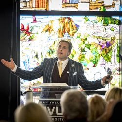 """Tom Holdman speaks at the unveiling of the """"Roots of Knowledge"""" in the Utah Valley University library in Orem on Friday, Nov. 18, 2016."""