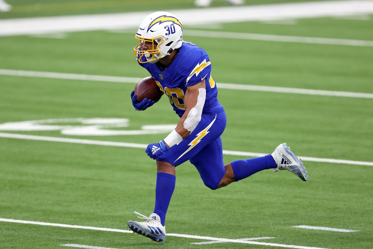 Austin Ekeler of the Los Angeles Chargers runs the ball against the Atlanta Falcons during the second quarter at SoFi Stadium on December 13, 2020 in Inglewood, California.