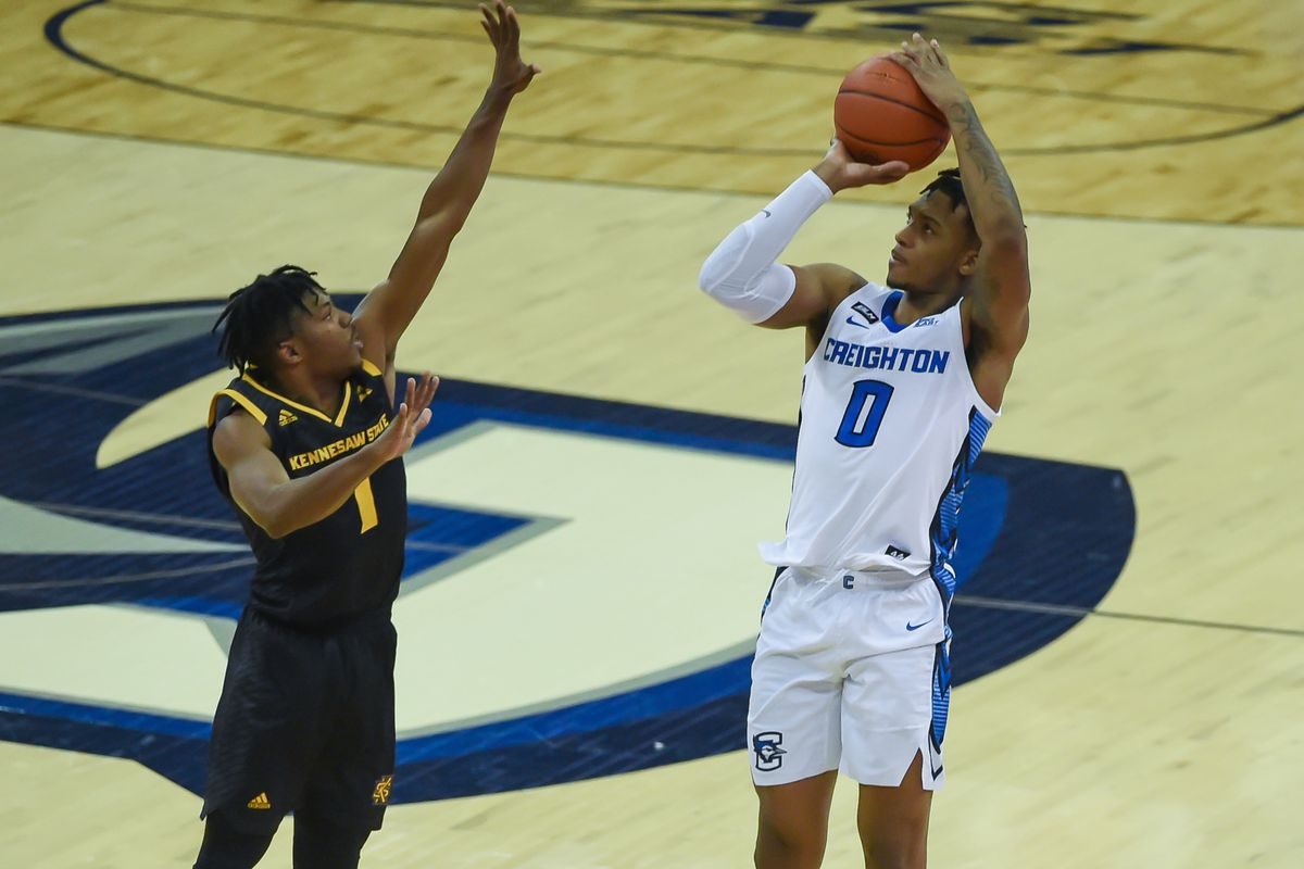 Creighton Bluejays guard Antwann Jones shoots over Kennesaw State Owls guard Terrell Burden in the second half at CHI Health Center Omaha.