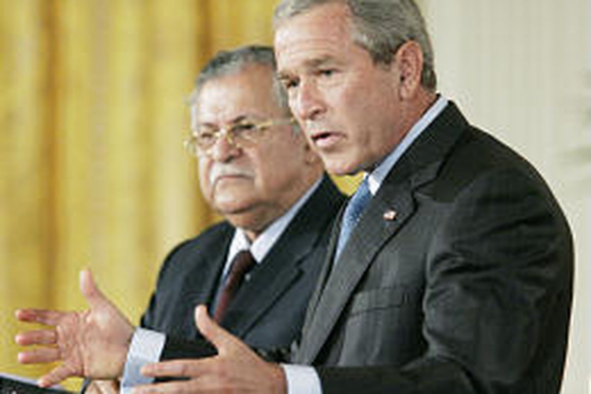 President Bush, with Iraqi President Jalal Talabani, speaks to the media during a news conference Tuesday at the White House.