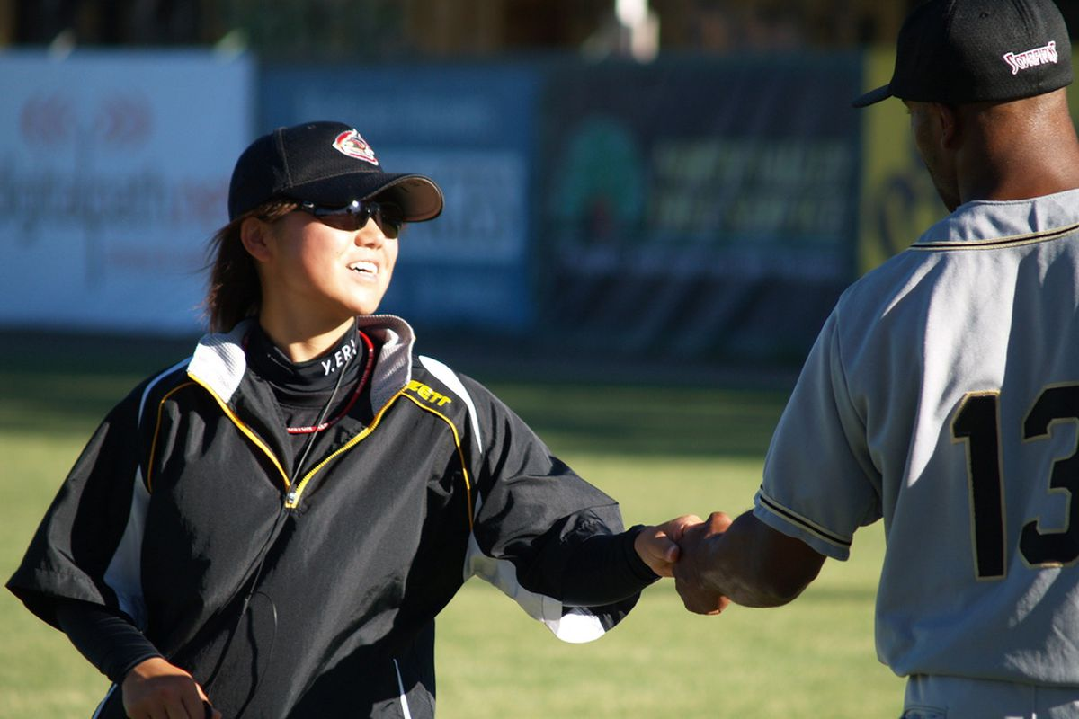 Chico Outlaws pitcher Eri Yoshida greets Yuma Scorpions left fielder Masjid Khairy before their June 12 game.
