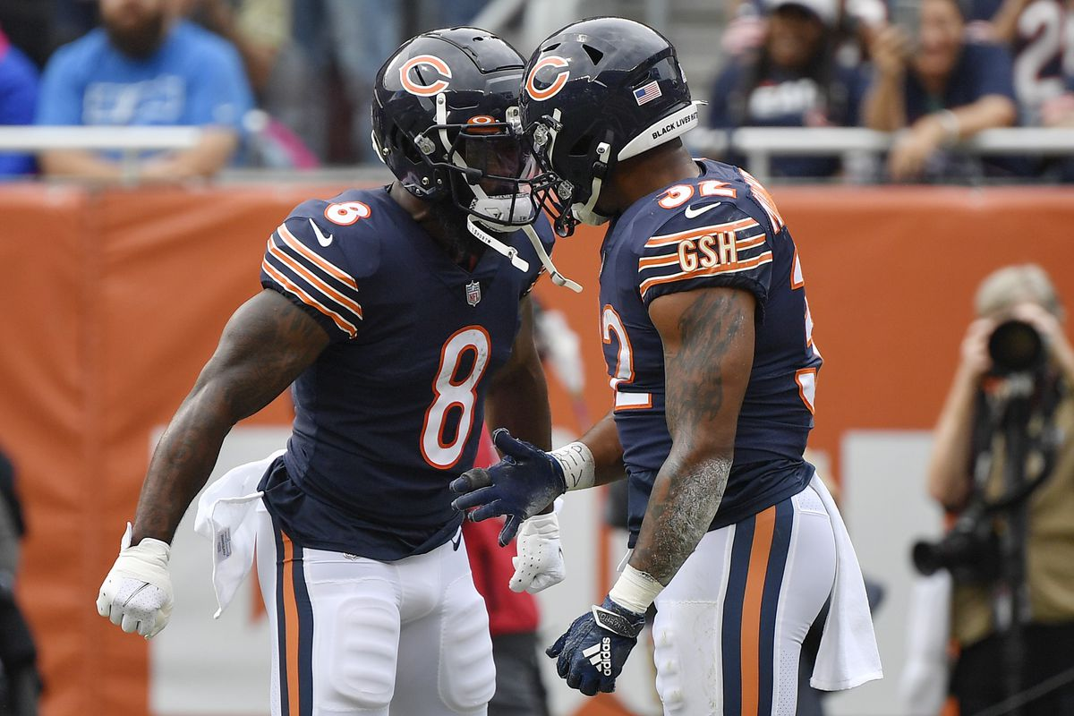 Chicago Bears running back Damien Williams (8) and running back David Montgomery (32) celebrate after scoring a touchdown the first half against the Detroit Lions at Soldier Field.