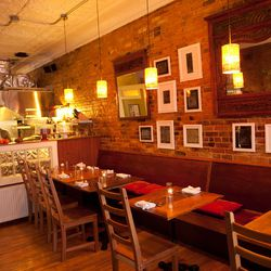 <strong>Figa,</strong> Munjoy Hill. Reclaimed wood tables, exposed brick and sackcloth dishtowels as napkins define tiny Figa's rustic aesthetic. A stickler for sustainability, chef/owner Lee Farrington used recycled materials to create her cozy, storefro