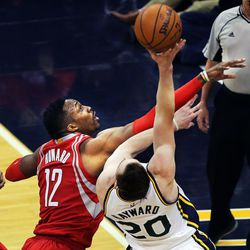 Former Houston Rockets center Dwight Howard (12) fouls Utah Jazz forward Gordon Hayward (20) during NBA basketball in Salt Lake City, Tuesday, Feb. 23, 2016.