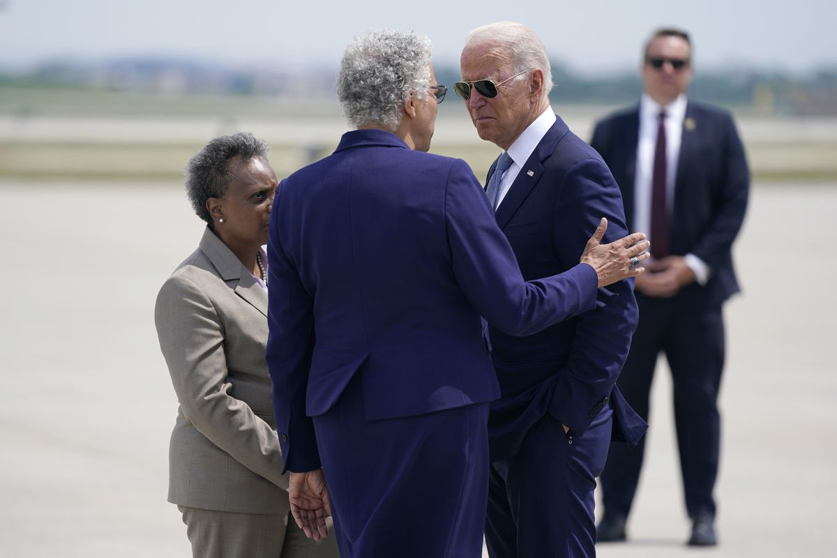 President Joe Biden is greeted by Cook County Board President Toni Preckwinkle, center, and Chicago Mayor Lori Lightfoot, left, as he arrives at O'Hare International Airport, Wednesday.