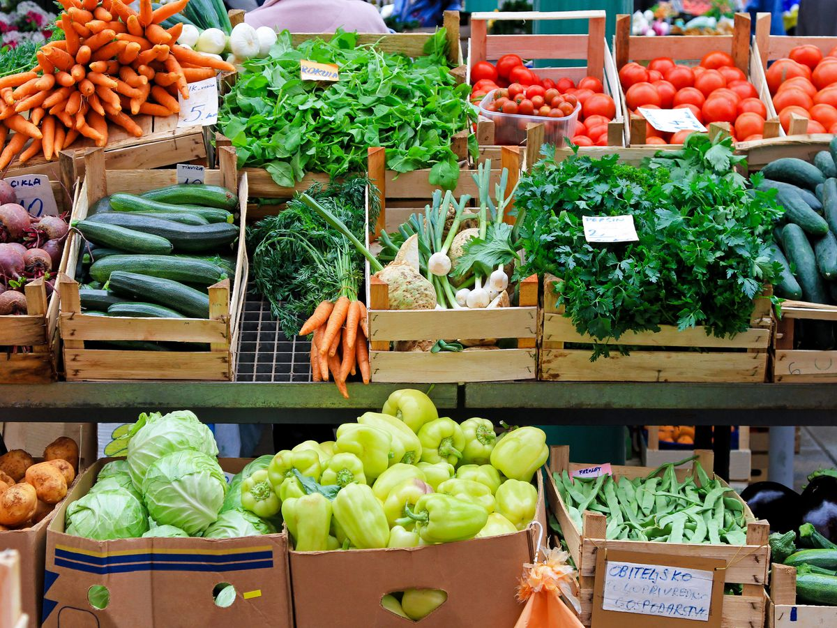 Boxes of fruit, vegetables, and produce at a market.