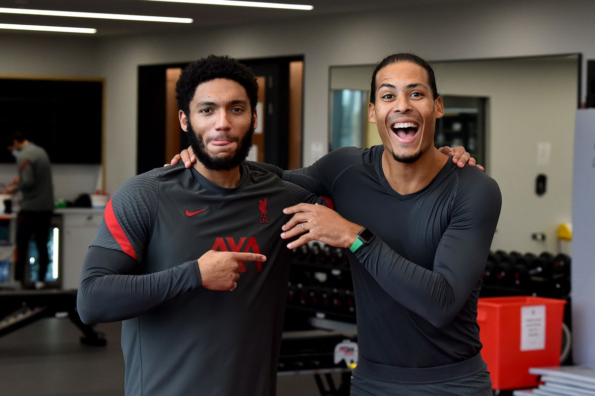 Virgil van Dijk and Joe Gomez have a laugh during a rehabilitation session at AXA Training Centre on February 19, 2021 in Kirkby, England.