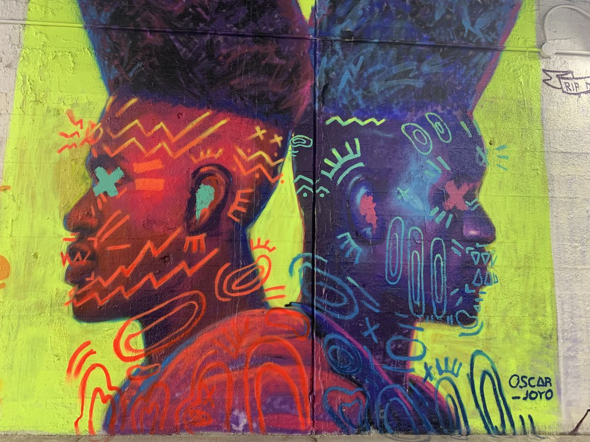 """Chicago artist Oscar Joyo says he was trying to get across """"the concept of being able to watch and protect one another. The extension of hair was an homage to '90s hair as well as a nod to pharaoh crowns and headpieces."""" The artwork was """"a cathartic moment, knowing that we can't move forward alone. In the midst of what has been going on, we need to lean on each other."""""""