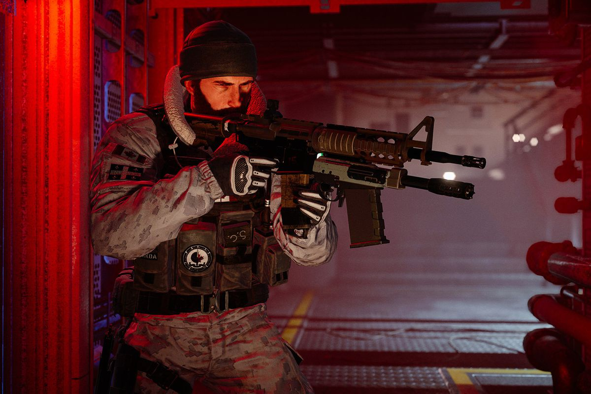 a soldier holding a gun in a red hallway