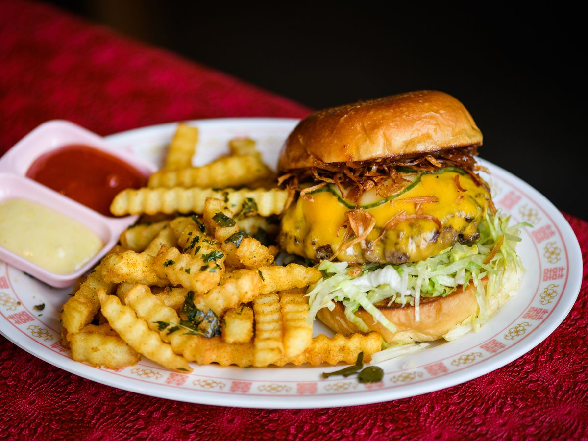 Cheeseburger with crinkle fries and ketchup and mayo from Oma's Hideaway