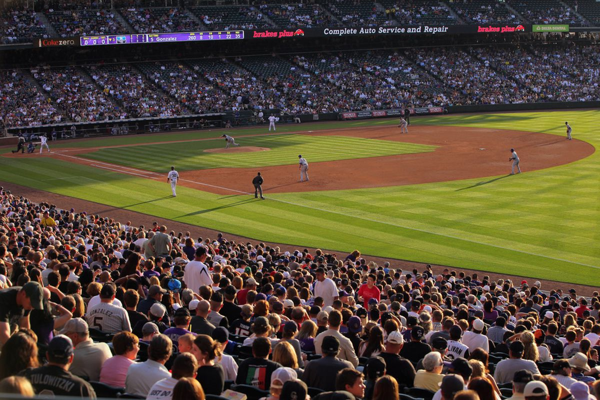 DENVER, CO - JUNE 10:  The evening light rakes across the infield as the Los Angeles Dodgers face the Colorado Rockies at Coors Field on June 10, 2011 in Denver, Colorado.  (Photo by Doug Pensinger/Getty Images)