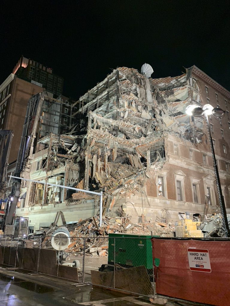 A partially demolished multi-story building.