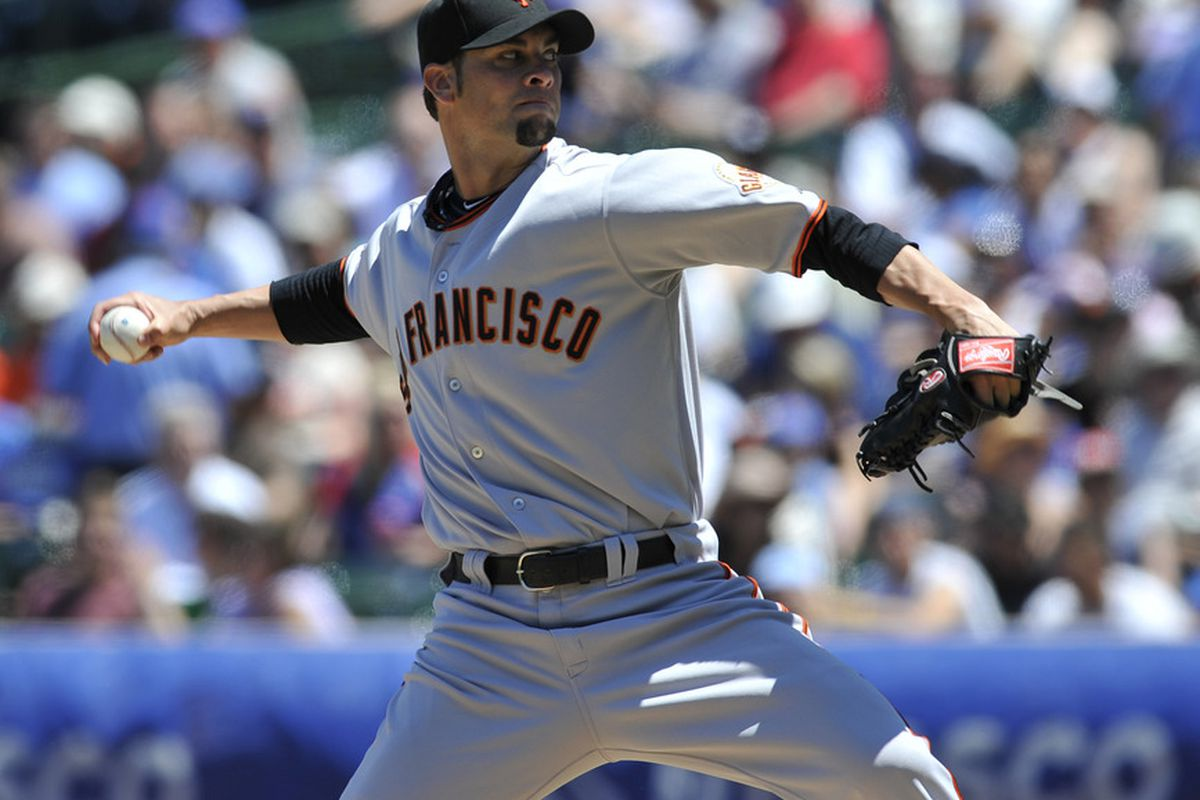 CHICAGO, IL - JUNE 28:  Ryan Vogelsong  # 32 of the San Francisco Giants pitches against the Chicago Cubs during the first game of a doubleheader on June 28, 2011 at Wrigley Field in Chicago, Illinois.  (Photo by David Banks/Getty Images)