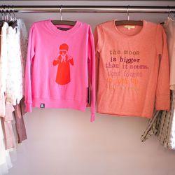 "Mini & Maximus, <a href=""http://www.honeyintherough.com/Mini-and-Maximus-Spy-Girl-Shirt.html/?"">$40</a>, Soft Gallery, <a href=""http://www.honeyintherough.com/Soft-Gallery-Harald-T-Shirt.html/?"">$60</a>"