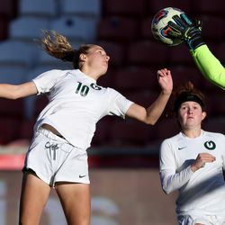 Olympus' Kelly Bullock tries to head the ball in as Bonneville goalkeeper Abree Beardall comes out for the save in the 5A girls soccer state championship at Rio Tinto Stadium in Sandy on Friday, Oct. 23, 2020.