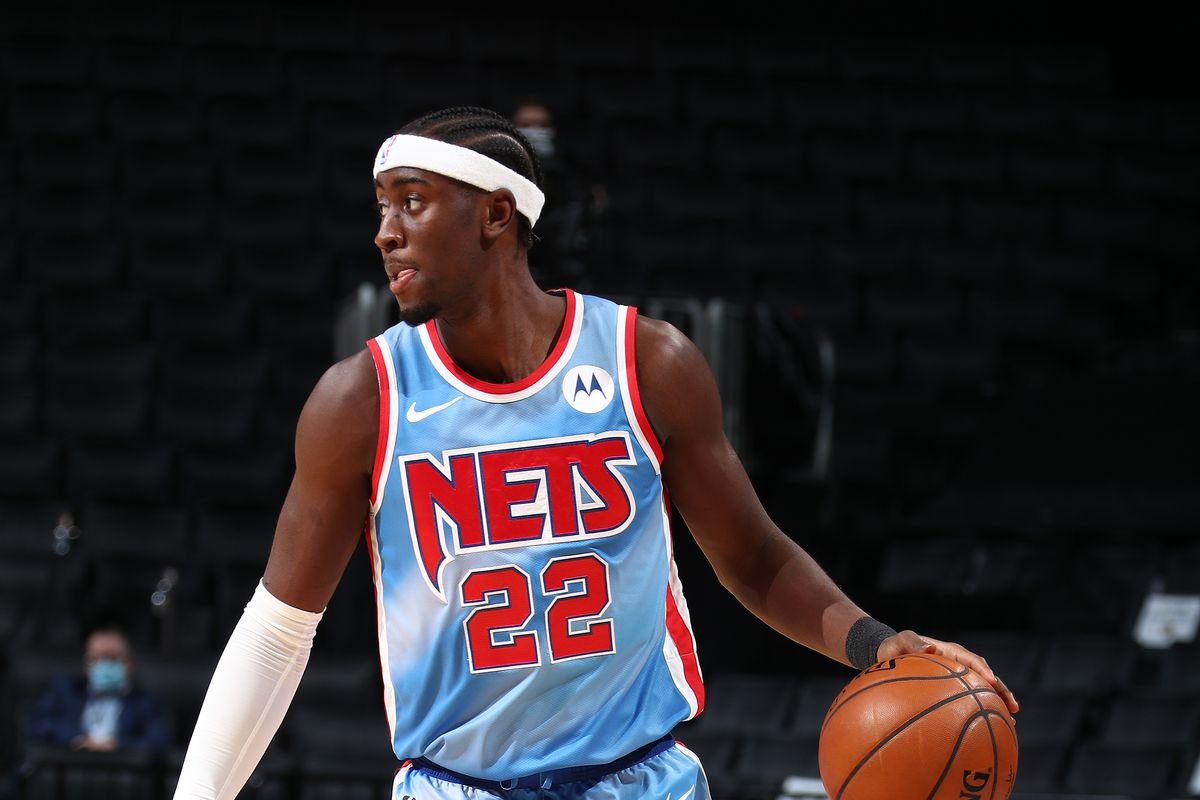 Caris LeVert #22 of the Brooklyn Nets dribbles the ball against the Denver Nuggets on January 12, 2021 at Barclays Center in Brooklyn, New York.