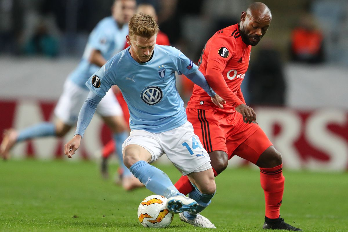 Anders Christiansen takes the ball from Besikta's Vagner Love - Malmo - Champions League