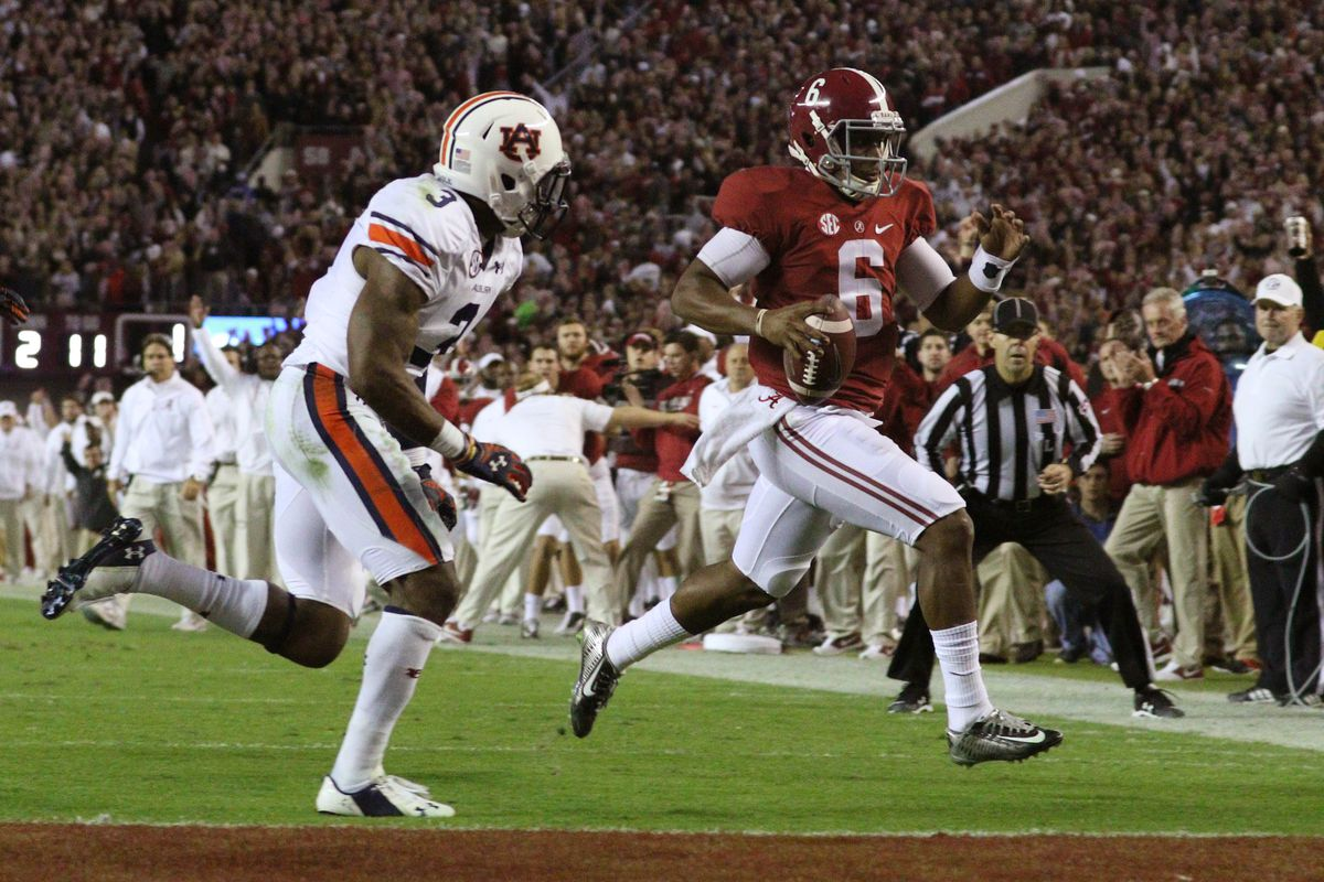 Alabama outlasted Auburn in the Iron Bowl and remains at No. 1 with just one week left in the season.