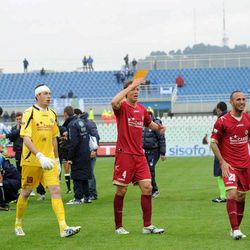 Soccer players react as medics assists Livorno's Piermario Morosini laying on the turf of the Pescara's Adriatico stadium, central Italy, Saturday, April 14, 2012, after he collapsed during a Serie B soccer match between Pescara and Livorno. Morosini, who was on loan from Udinese, fell to the ground in the 31st minute of the match and received urgent medical attention on the pitch. A defibrillator was also used on the 25-year-old. The match was called off, with the other players leaving the field in tears.