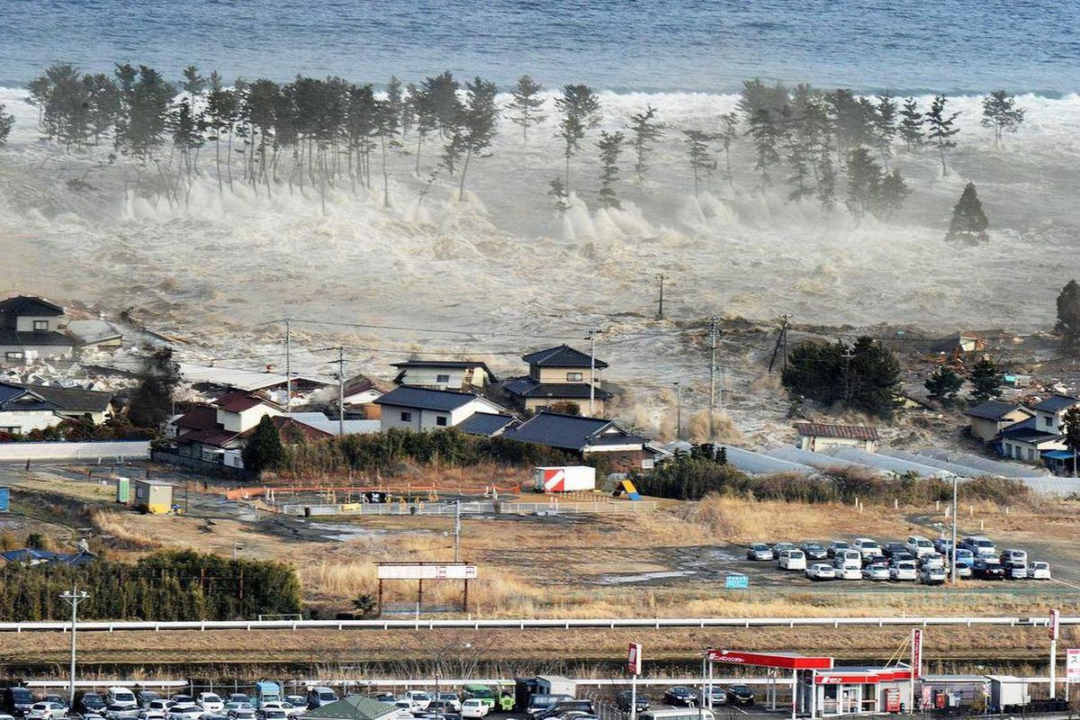 FILE -In this March 11, 2011 file photo, waves of a tsunami hit residences after a powerful earthquake in Natori, Miyagi prefecture (state), Japan.  A government-commissioned panel of experts said Saturday March 31, 2012 a tsunami unleashed by a magnitude