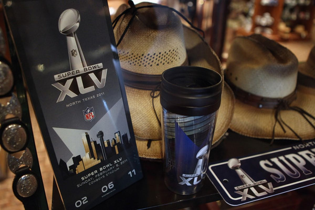 ARLINGTON TX - FEBRUARY 04:  Super Bowl merchandise sits in a store window ahead of Super Bowl XLV at  on February 4 2011 in Arlington Texas.  (Photo by Streeter Lecka/Getty Images)