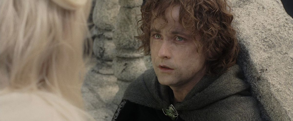 Pippin listens to Gandalf in The Return of the King.