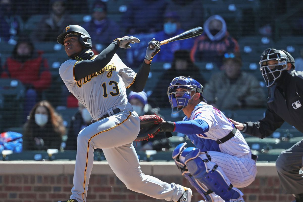 Ke'Bryan Hayes #13 of the Pittsburgh Pirates hits a two run home run in the 1st inning against the Chicago Cubs during the Opening Day home game at Wrigley Field on April 01, 2021 in Chicago, Illinois.