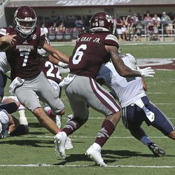 Mississippi State quarterback Nick Fitzgerald (7) receives a block from wide receiver Donald Gray (6) allowing him to score a touchdown during the first half of an NCAA college football game against BYU in Starkville, Miss., Saturday, Oct. 14, 2017. (AP Photo/Jim Lytle)