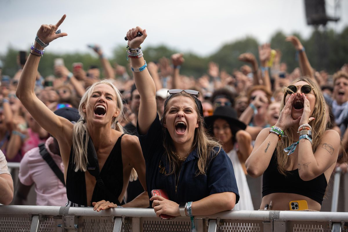 Festival goers cheer during Polo G's show.