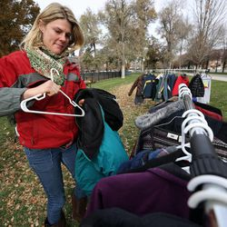 Karon Barnes looks at coats at the 10th annual Community Coat Exchange at Pioneer Park in Salt Lake City on Friday, Nov. 28, 2014.