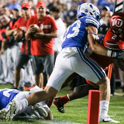Brigham Young Cougars defensive back Zayne Anderson (23) pushes Utah Utes running back Zack Moss (2) out of bounds just shy of a touchdown at LaVell Edwards Stadium in Provo on Saturday, Sept. 9, 2017.