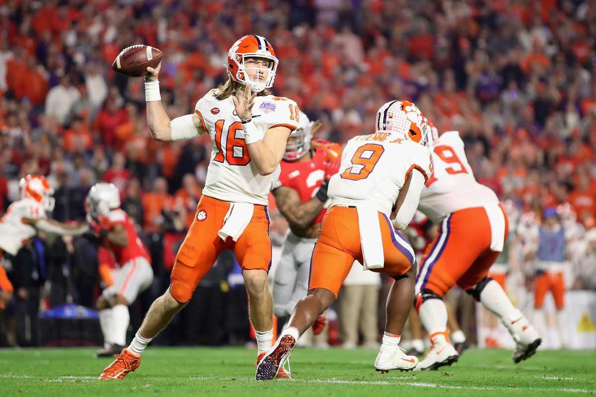 Quarterback Trevor Lawrence of the Clemson Tigers drops back to pass during the PlayStation Fiesta Bowl against the Ohio State Buckeyes at State Farm Stadium on December 28, 2019 in Glendale, Arizona.