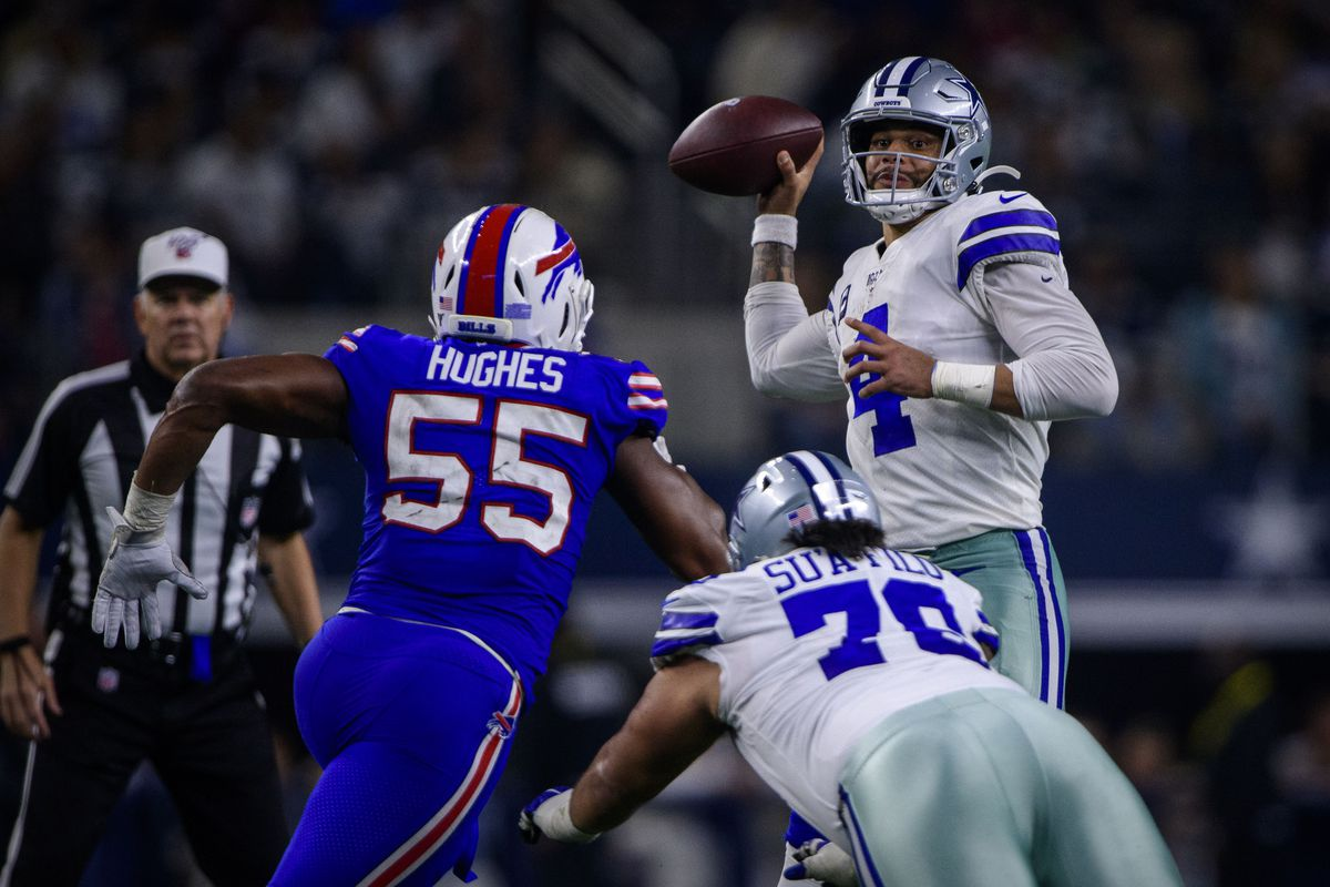 Buffalo Bills defensive end Jerry Hughes and Dallas Cowboys quarterback Dak Prescott (4) in action during the game between the Bills and Cowboys at AT&T Stadium.