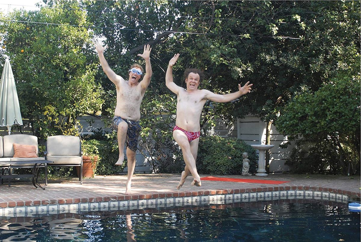 Ferrell and Reilly jumping into a pool