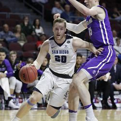 San Diego's Cameron Neubauer drives around Portland's Philipp Hartwich Friday, March 3, 2017, in Las Vegas. Neubauer is from Germany.