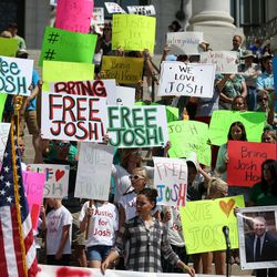 People hold signs calling for the freeing of Josh Holt at the Capitol in Salt Lake City on Saturday, July 30, 2016. Family members and supporters held a rally to call for the release of Josh Holt, who has been jailed in Venezuela.