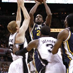 SAN ANTONIO, TX - APRIL 29:  Paul Millsap #24 of the Utah Jazz takes a shot against Matt Bonner #15 of the San Antonio Spurs in Game One of the Western Conference Quarterfinals in the 2012 NBA Playoffs at AT&T Center on April 29, 2012 in San Antonio, Texas.