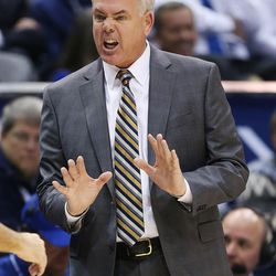 Brigham Young Cougars head coach Dave Rose shouts at a ref in Provo on Saturday, Dec. 16, 2017. BYU won 77-65.