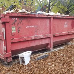 A dumpster that was placed outside the home during the rehab.   Provided/Tony Ruiz