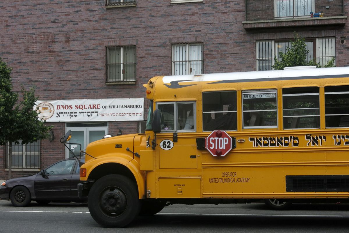 A school bus sits outside an all girls Jewish school in Williamsburg.