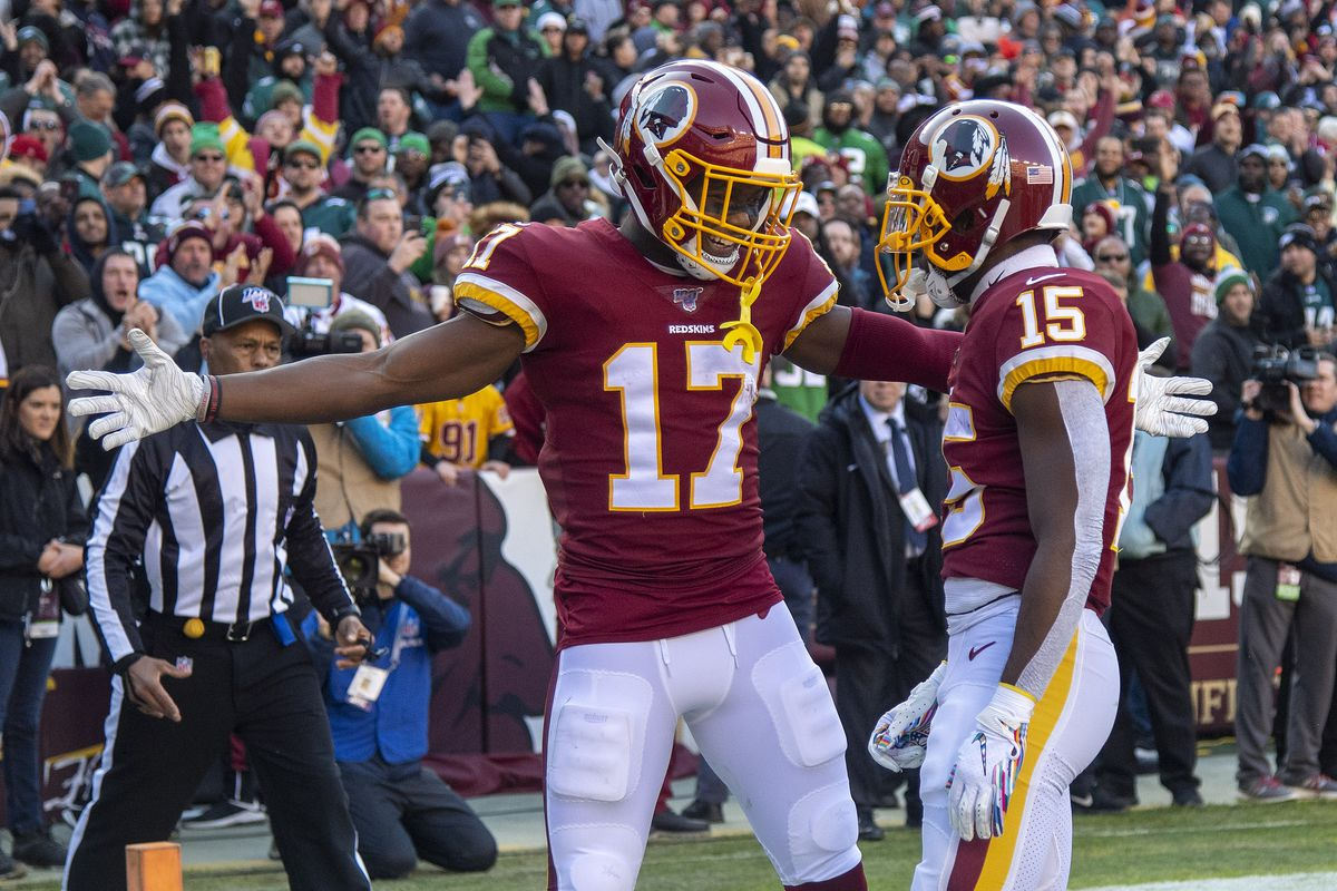 Washington Redskins wide receiver Steven Sims is congratulated by wide receiver Terry McLaurin after scoring a touchdown against the Philadelphia Eagles during the first half at FedExField